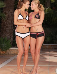 Lesbian bikini sweethearts rubbing their moist tight cunts